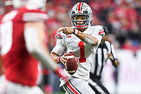 Indianapolis, IN - DEC 7, 2019: Ohio State Buckeyes quarterback Justin Fields (1) directs traffic on the run during Big Ten Championship game between Wisconsin and Ohio State at Lucas Oil Stadium in Indianapolis, IN. Ohio State came back from a 21-7 deficit at halftime to beat Wisconsin 34-21 to win its third straight Big Ten Championship. (Photo by Phillip Peters/Media Images International)