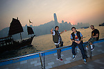 B-Boys Taisuke, Ronnie and Lilou in pose on Hong Kong's Victoria Harbour waterfront.