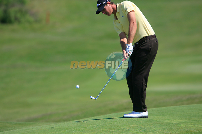 Nicolas Colsaerts (BEL) chips onto the 11th green during the afternoon Quarter Final session on Day 3 of the Volvo World Match Play Championship in Finca Cortesin, Casares, Spain, 21st May 2011. (Photo Eoin Clarke/Golffile 2011)