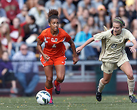 University of Miami midfielder Jordan Roseboro (6) dribbles as Boston College midfielder Kate McCarthy (21) closes..After two overtime periods, Boston College (gold) tied University of Miami (orange), 0-0, at Newton Campus Field, October 21, 2012.