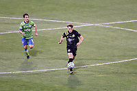 COLUMBUS, OH - DECEMBER 12: Aidan Morris #21 of the Columbus Crew is chased by Nicolas Lodeiro #10 of the Seattle Sounders FC during a game between Seattle Sounders FC and Columbus Crew at MAPFRE Stadium on December 12, 2020 in Columbus, Ohio.