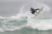 American Tanner Gudauskas gets airborne during round of 48 at the 2010 US Open of Surfing in Huntington Beach, California on August 5, 2010.