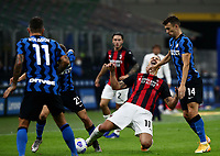 Calcio, Serie A: Inter Milano - AC Milan , Giuseppe Meazza (San Siro) stadium, in Milan, October 17, 2020.<br /> Milan's Zlatan Ibrahimovic (c) in action with Inter's Ivan Perisic (r) and Nicoò Barella (l) during the Italian Serie A football match between Inter and Milan at Giuseppe Meazza (San Siro) stadium, October 17,  2020.<br /> UPDATE IMAGES PRESS/Isabella Bonotto