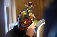 Summary: For Sidewalks. Artist James Kuhn uses his face as a canvas by painting a new image on it every day for a year in his home in Three Oaks, Mich, Saturday, Jan. 3, 2009. This painting is a violin which includes a hand made paper neck he attaches to his forehead.