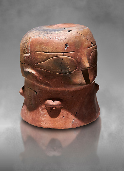 Terracotta Vase with female face. Catalhoyuk Collections. Museum of Anatolian Civilisations, Ankara. Against a gray mottled background