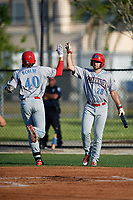 Clearwater Threshers Alec Bohm (40) high fives Matt Vierling (28) after hitting a home run during a Florida State League game against the Dunedin Blue Jays on May 11, 2019 at Jack Russell Memorial Stadium in Clearwater, Florida.  Clearwater defeated Dunedin 9-3.  (Mike Janes/Four Seam Images)