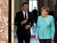 Il presidente del Consiglio Matteo Renzi, sinistra, e il cancelliere tedesco Angela Merkel a Palazzo Chigi, Roma, 5 maggio 2016.<br /> Italian Premier Matteo Renzi, left, and German Chancellor Angela Merkel arrive to attend a joint press conference following their talks at Chigi Palace, Rome, 5 May 2016.<br /> UPDATE IMAGES PRESS/Isabella Bonotto