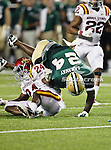 Baylor Bears running back Terrance Ganaway (24) and Iowa State Cyclones defensive back Durrell Givens (24) in action during the game between the Iowa State Cyclones and the Baylor Bears at the Floyd Casey Stadium in Waco, Texas. Baylor defeats Iowa State 49 to 26.