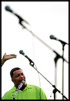 "Pastor Billy Strange of the First Missionary Baptist Church leads his gospel praise choir in a lively rendition of ""Amazing Grace"" to open the 2006 Goombay Summer Fest on the waterfront in Key West, FL on July 8, 2006. (Brian Ray for Key West Magazine)"