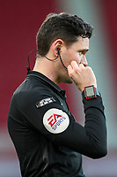 Assistant referee Shaun Hudson checks his earpiece<br /> <br /> Photographer Alex Dodd/CameraSport<br /> <br /> The EFL Sky Bet Championship - Middlesbrough v Norwich City - Saturday 21st November 2020 - Riverside Stadium - Middlesbrough<br /> <br /> World Copyright © 2020 CameraSport. All rights reserved. 43 Linden Ave. Countesthorpe. Leicester. England. LE8 5PG - Tel: +44 (0) 116 277 4147 - admin@camerasport.com - www.camerasport.com