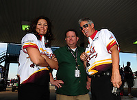 Sept. 25, 2011; Ennis, TX, USA: NHRA funny car driver Melanie Troxel (left) with crew member Jason Sharp during the Fall Nationals at the Texas Motorplex. Mandatory Credit: Mark J. Rebilas-