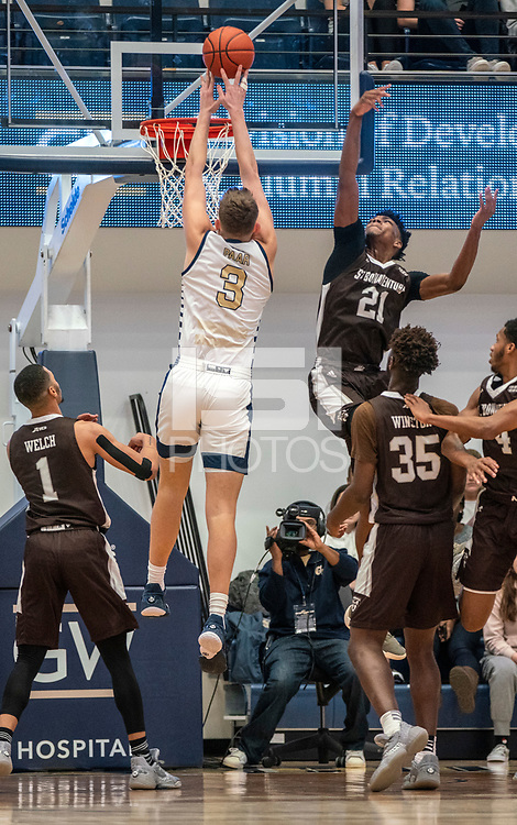 WASHINGTON, DC - JANUARY 5: Chase Paar #3 of George Washington gets off a shot over Osun Osunniyi #21 of St. Bonaventure during a game between St. Bonaventure University and George Washington University at Charles E Smith Center on January 5, 2020 in Washington, DC.