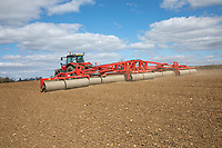 Rolling spring barley after drillling - Suffolk, April