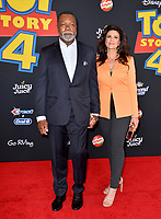 "LOS ANGELES, USA. June 12, 2019: Carl Weathers & Guest at the world premiere of ""Toy Story 4"" at the El Capitan Theatre.<br /> Picture: Paul Smith/Featureflash"