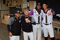 """Akron RubberDucks Gianpaul Gonzalez, Alexis Pantoja, Oscar Gonzalez (38), and Nolan Jones (17) before an Eastern League game against the Erie SeaWolves on August 30, 2019 at Canal Park in Akron, Ohio.  Akron wore special jerseys with the slogan """"Fight Like a Kid"""" during the game for Akron Children's Hospital Home Run for Life event, the design was created by 11 year old Macy Carmichael.  Erie defeated Akron 3-2.  (Mike Janes/Four Seam Images)"""