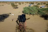 KENYA, Lodwar, water tank and solar panel for NAPUU drip irrigation scheme by the county government, the water is pumped by solar powered pump / KENIA Turkana, Lodwar, Wassertank und Solaranlage fuer Betrieb einer Wasserpumpe fuer eine 30 ha Farm mit Troepfchenbewaesserung