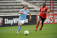 Chicago forward Karen Carney (14) speeds away from Atlanta defender Kia McNeill (6).  The Chicago Red Stars tied the Atlanta Beat 0-0 at Toyota Park in Bridgeview, IL on June 6, 2010.