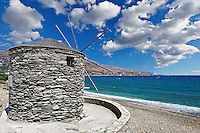 A windmill on the beach of Korthi in Andros island, Greece
