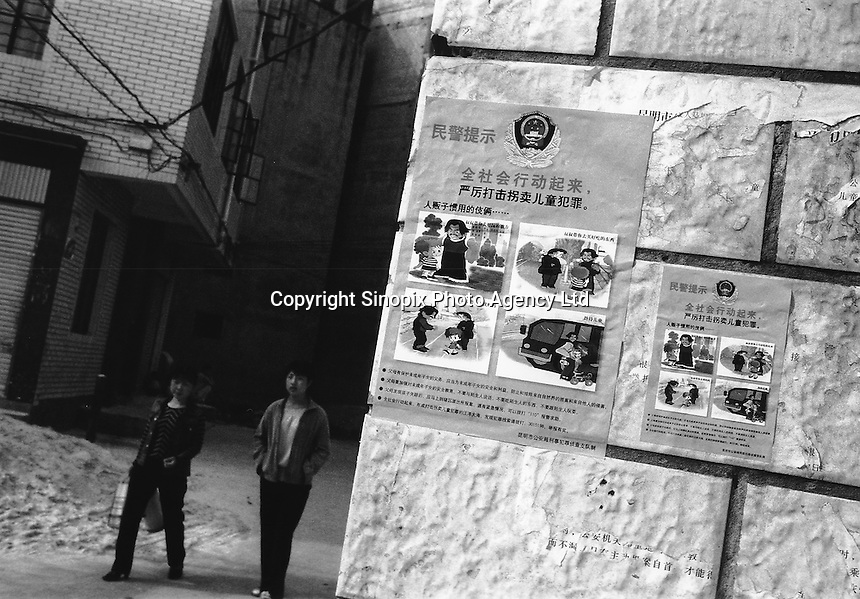 Posters on a wall in the Guangdu district of Kunming City, China, warn parents of the human traffickers gangs that prey on the young boys in the area. Thousands of migrant mothers' children have been stolen and sold to rich families desperate for a boy. Families are limited to a single child under the China's ruthless One Child Policy...PHOTO BY SINOPIX..