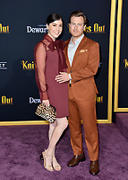 "LOS ANGELES, USA. November 15, 2019: Noah Segan & Alison Bennett at the premiere of ""Knives Out"" at the Regency Village Theatre.<br /> Picture: Paul Smith/Featureflash"
