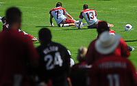 Jul 31, 2009; Flagstaff, AZ, USA; Arizona Cardinals quarterbacks Matt Leinart (7) and Kurt Warner (13) stretch during training camp on the campus of Northern Arizona University. Mandatory Credit: Mark J. Rebilas-