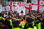 "© Joel Goodman - 07973 332324 . 05/05/2012 .  Luton , UK . A "" Ban the burkha "" placard is raised in the crowd . Approximately 1,500 people take part in an EDL ( English Defence League ) march in Luton , understood to have been policed by over 1,000 officers . Photo credit: Joel Goodman"