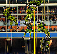 7 December 2008: Members of the Canadian Armed Forces rappel down from the roof of Skydome to the playing field to deliver the official game ball prior to a game between the Miami Dolphins and the Buffalo Bills. The game was the first regular season NFL game ever played in Canada. The Dolphins defeated the Bills 16-3 at the Rogers Centre in Toronto, Ontario. ..Mandatory Photo Credit: Ed Wolfstein Photo