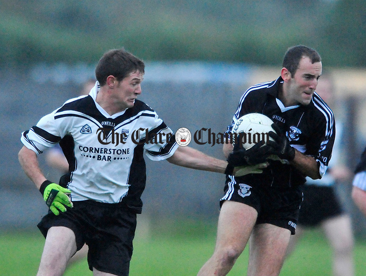 Doonbeg's Padraic Aherne gathers the ball ahead of Ennistymon's Kevin Scales. Photograph by Declan Monaghan
