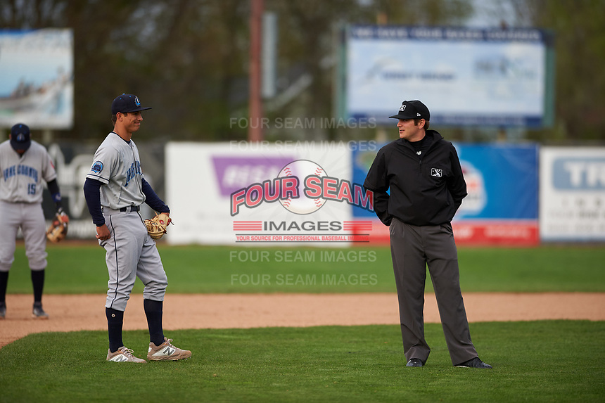 Umpire Jeff Hamann talks to Captains shortstop Tyler Freeman (7) during a Midwest League game between the Lake County Captains and Beloit Snappers at Pohlman Field on May 6, 2019 in Beloit, Wisconsin. Lake County defeated Beloit 9-1. (Zachary Lucy/Four Seam Images)