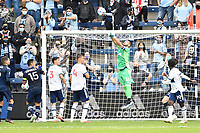 KANSAS CITY, KS - MAY 16: Maxime Crepeau #16 Vancouver Whitecaps punches the ball clear during a game between Vancouver Whitecaps and Sporting Kansas City at Children's Mercy Park on May 16, 2021 in Kansas City, Kansas.