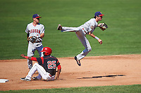Auburn Doubledays shortstop Clayton Brandt (3) throws to first base over a sliding Samuel Castro (25) as Paul Panaccione (9) backs up the play during a game against the Batavia Muckdogs on September 5, 2016 at Dwyer Stadium in Batavia, New York.  Batavia defeated Auburn 4-3. (Mike Janes/Four Seam Images)