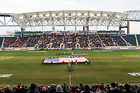 Fans and players stand during the playing of the national anthem prior to the start of the match. The Notre Dame Fighting Irish defeated the Maryland Terrapins 2-1 during the championship match of the division 1 2013 NCAA  Men's Soccer College Cup at PPL Park in Chester, PA, on December 15, 2013.