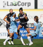 Stephanie Cox (14) of the Los Angeles Sol heads the ball between Natasha Kai (6) and Heather O'Reilly (9) of Sky Blue FC. The Los Angeles Sol defeated Sky Blue FC 2-0 during a Women's Professional Soccer match at TD Bank Ballpark in Bridgewater, NJ, on April 5, 2009. Photo by Howard C. Smith/isiphotos.com