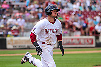 Wisconsin Timber Rattlers catcher Payton Henry (15) runs to first base during a Midwest League game against the Burlington Bees on May 19, 2018 at Fox Cities Stadium in Appleton, Wisconsin. Wisconsin defeated Burlington 1-0. (Brad Krause/Four Seam Images)