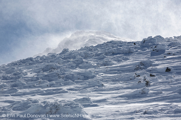 Strong winds blow snow across the open ridge of the Presidential Range along the Air Line Trail in the White Mountains, New Hampshire during the winter months.