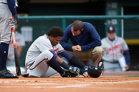 Gwinnett Braves left fielder Ronald Acuna (24) gets looked at by trainer Nick Flynn after fouling a pitch off his ankle during a game against the Buffalo Bisons on August 19, 2017 at Coca-Cola Field in Buffalo, New York.  Gwinnett defeated Buffalo 1-0.  (Mike Janes/Four Seam Images)
