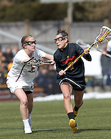 University of Maryland midfielder Katie Schwarzmann (7) on the attack as Boston College midfielder Sarah Mannelly (6) defends..University of Maryland (black) defeated Boston College (white), 13-5, on the Newton Campus Lacrosse Field at Boston College, on March 16, 2013.
