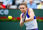 Simona Halep (ROU) during her quarterfinal match against Carla Suarez Navarro (ESP). Halep advanced after defeating Suarez Navarro by 57 61 61 at the BNP Parisbas Open in Indian Wells, CA on March 18, 2015.
