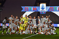Juventus players celebrate the victory of the italian championship at the end of the Serie A football match between Juventus FC and AS Roma at Juventus stadium in Turin (Italy), August 1st, 2020. Play resumes behind closed doors following the outbreak of the coronavirus disease. Photo Andrea Staccioli / Insidefoto