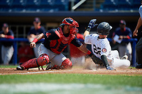 Lowell Spinners catcher Alberto Schmidt (20) tags Bill Springman (22) as he slides home safely during a game against the Staten Island Yankees on August 22, 2018 at Richmond County Bank Ballpark in Staten Island, New York.  Staten Island defeated Lowell 10-4.  (Mike Janes/Four Seam Images)