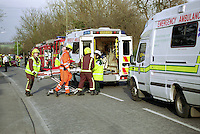 Firefighters, a HEMS doctor and paramedics rushing a casualty on a stretcher from a road traffic accident to an awaiting ambulance. The Helicopter Emergency Medical Service is an air ambulance service that serves London and carries a doctor, a paramedic and two pilots, and is based at The Royal London Hospital...© SHOUT. THIS PICTURE MUST ONLY BE USED TO ILLUSTRATE THE EMERGENCY SERVICES IN A POSITIVE MANNER. CONTACT JOHN CALLAN. Exact date unknown.john@shoutpictures.com.www.shoutpictures.com..