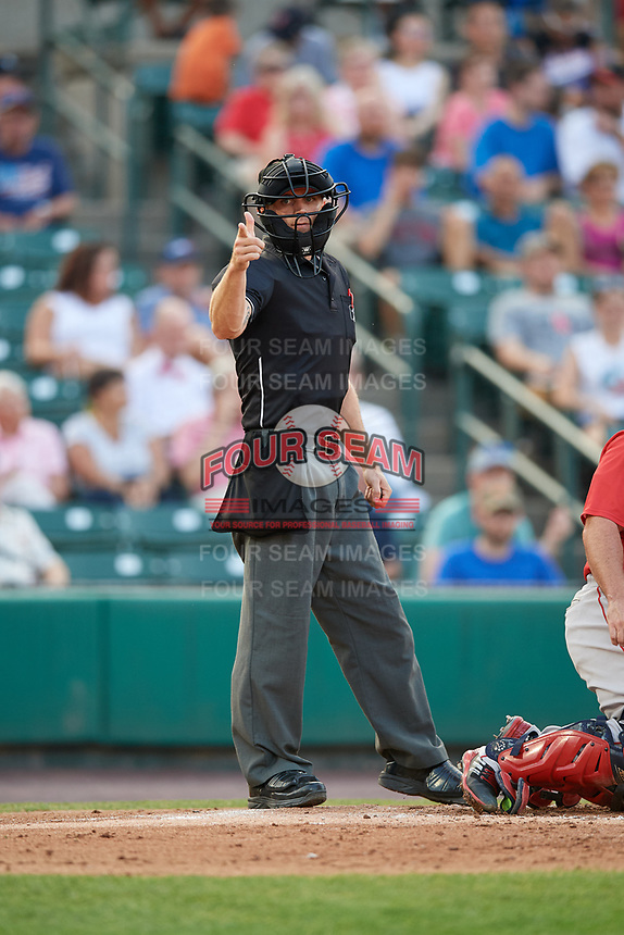 Home plate umpire Reid Gibbs calls a strike during a game between the Pawtucket Red Sox and the Rochester Red Wings on July 4, 2018 at Frontier Field in Rochester, New York.  Pawtucket defeated Rochester 6-5.  (Mike Janes/Four Seam Images)