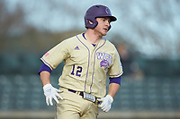 Kitt Capell (12) of the Western Carolina Catamounts hustles down the first base line against the Saint Joseph's Hawks at TicketReturn.com Field at Pelicans Ballpark on February 23, 2020 in Myrtle Beach, South Carolina. The Hawks defeated the Catamounts 9-2. (Brian Westerholt/Four Seam Images)
