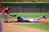 Tampa Bay Rays Jose Paez (64) slides head first into second base as Luis Alejandro Basabe (16) looks to apply the tag during a minor league Spring Training game against the Boston Red Sox on March 23, 2016 at Charlotte Sports Park in Port Charlotte, Florida.  (Mike Janes/Four Seam Images)