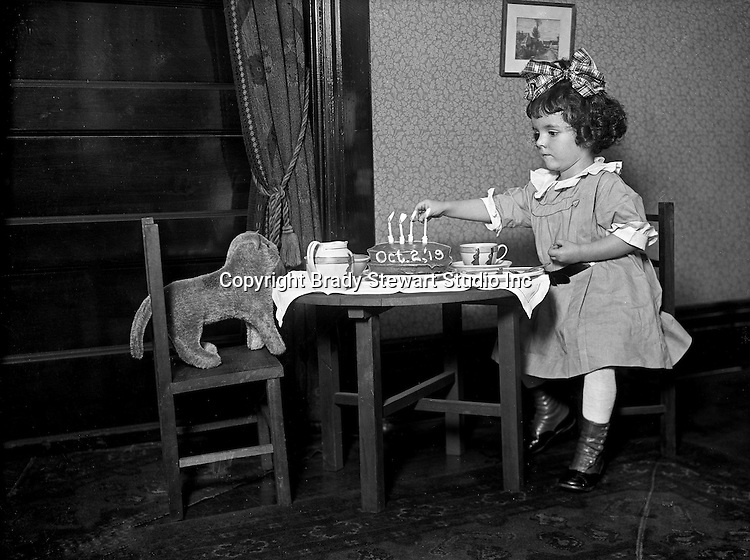 Wilkinsburg PA:  Helen Stewart and her stuffed dog having a birthday party.