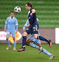 6th June 2021; AAMI Park, Melbourne, Victoria, Australia; A League Football, Melbourne Victory versus Melbourne City; Leigh Broxham of the Victory leaps brings down the high ball on his chest