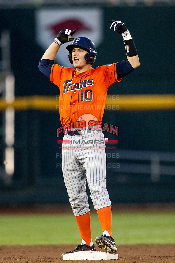 Cal State Fullerton Titans catcher A.J. Kennedy (10) celebrates an RBI double during the NCAA College baseball World Series against the Vanderbilt Commodores on June 14, 2015 at TD Ameritrade Park in Omaha, Nebraska. The Titans were leading 3-0 in the bottom of the sixth inning when the game was suspended by rain. (Andrew Woolley/Four Seam Images)