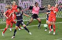 LA Sol's Han Duan does battle with  Washington Freedom's defence. The LA Sol defeated the Washington Freedom 2-0 in the opening game of Womens Professional Soccer at Home Depot Center stadium on Sunday March 29, 2009.  .Photo by Michael Janosz