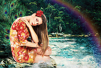 Digitally enhanced creative glamour portrait of a young woman wearing a floral dress.