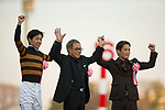 FUNABASHI,JAPAN-DECEMBER 24: Kitasan Black's connections,Yutaka Take (jockey),Saburo Kitajima (owner) and Hisashi Shimizu (trainer) from left, after winning the Arima Kinen at Nakayama Racecourse on December 24,2017 in Funabashi,Chiba,Japan (Photo by Kaz Ishida/Eclipse Sportswire/Getty Images)